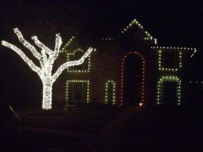 wrapping trees with lights light installation in pearland hang