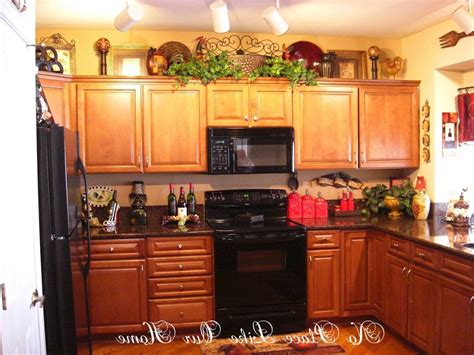 ideas for decorating top of kitchen cabinets whats on top of your kitchen cabinets home decorating