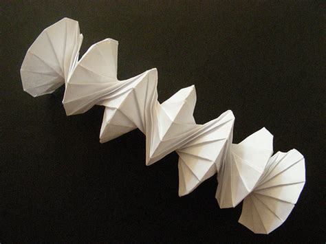origami between the folds independent lens between the folds