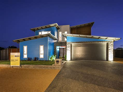 modern two storey house with streamline roof blue modern two story house by by streamline