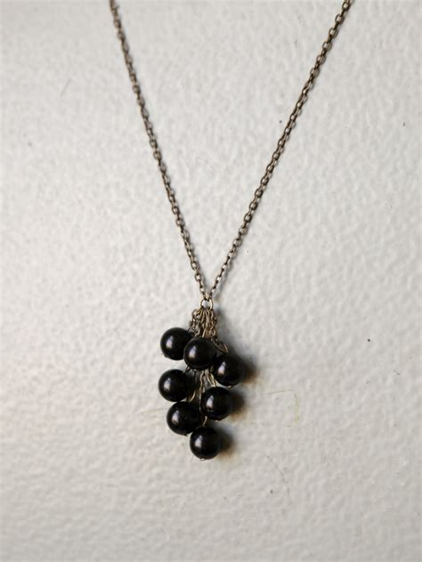 black necklace black bead cluster necklace a common thread