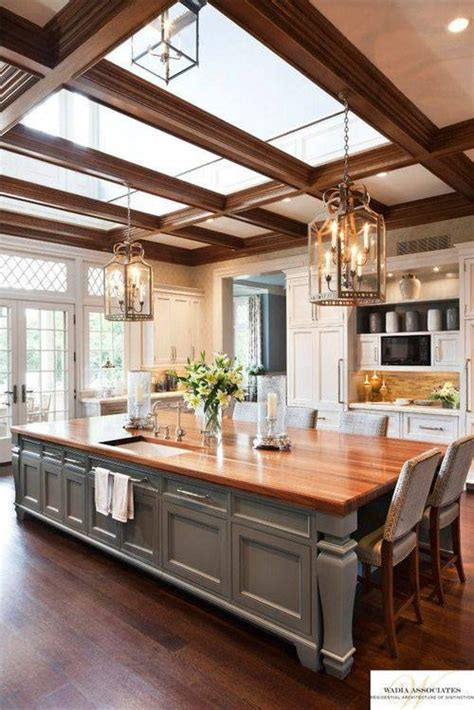 oversized kitchen island this large kitchen has an island that doubles as a table and sky lights above to bring in the