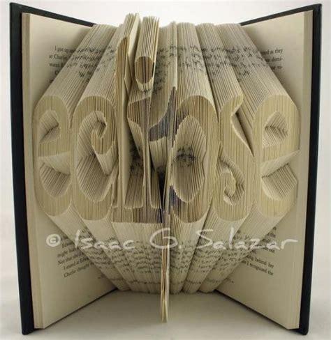 origami book folding books transformed into 3 d origami symbols recyclenation