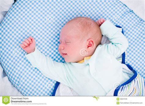 swaddling baby in crib swaddled baby in white bed stock photo image