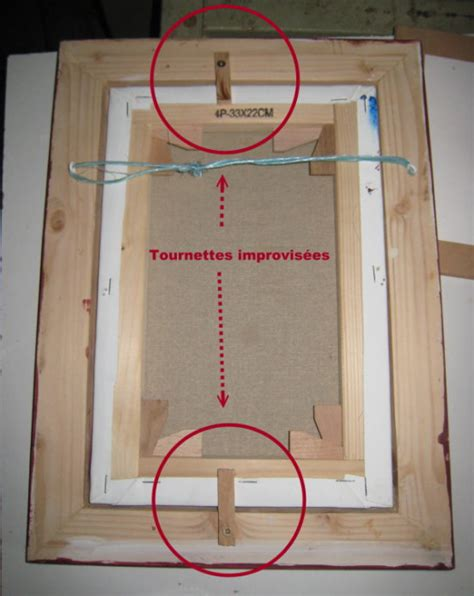 fixer un tableau dans cadre fixer le paquet