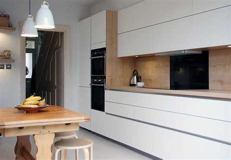 German Design Kitchens satin white handleless kitchen with oak in tunbridge wells