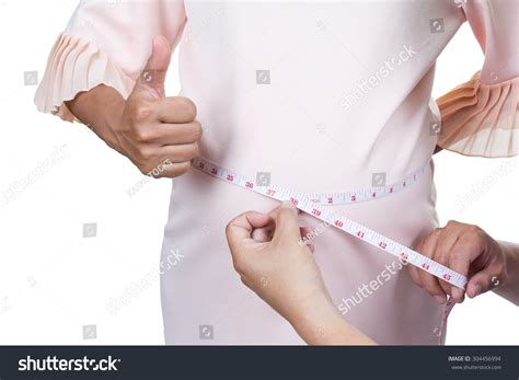 meaning of waist measuring waist whit feel stock photo