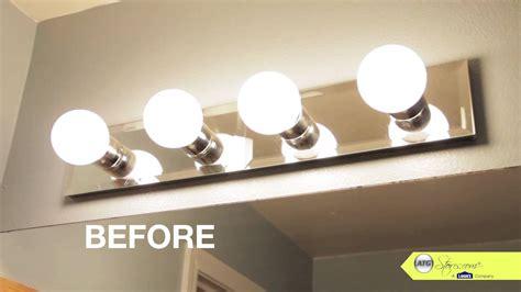 change bathroom light fixture bathroom makeover tip replace your bathroom lighting