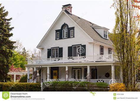 House Plans With Wrap Around Porches white house with a wraparound porch stock photo image