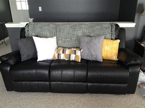 black throw pillows for sofa lighten up a black leather with bright pillows and a
