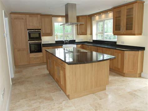 oak kitchen designs black granite worktop with floor tiles