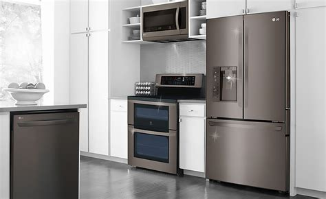 white kitchen cabinets with stainless steel appliances black stainless steel appliances are a kitchen must
