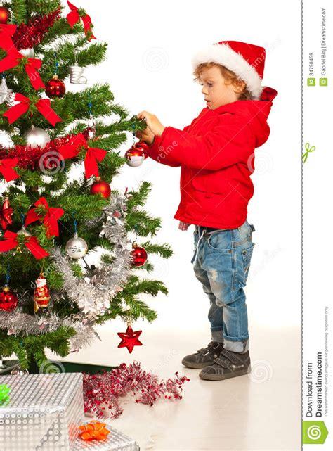 tree decorating images toddler boy decorate tree stock image image 34796459
