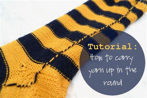 knitting stripes in the carrying yarn knitting tutorial how to carry up yarn in the