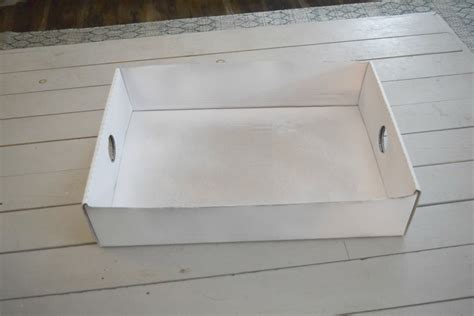 spray painting cardboard boxes creating a simple storage bin using rope and a cardboard