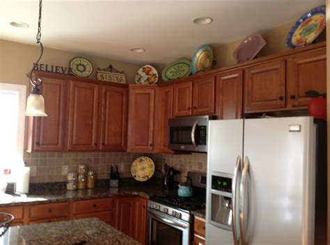 ideas for decorating top of kitchen cabinets 19 best images about kitchen top of cabinets on
