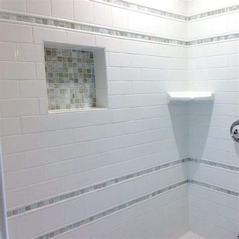 Subway Tile Designs For Bathrooms classic white subway tiles and glass mosaic accents