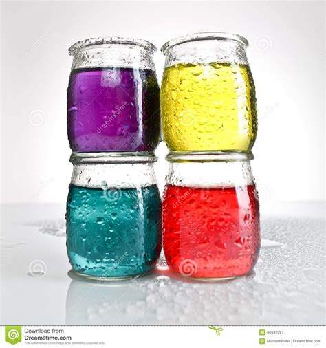 colored water jars of colored water stacked stock image image 40442287