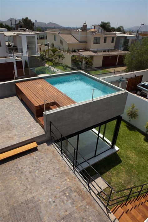 Glass Top Dining Room Set house with rooftop pool