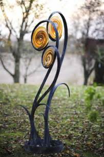 metal garden flowers sculpture forged steel and blown glass garden or yard outside and