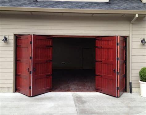 7 foot garage door bi fold carriage doors 16 ft x 8 ft insulated wood