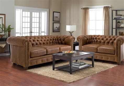 living room with 2 sofas and vintage brown leather tufted sofa with 2 and 3