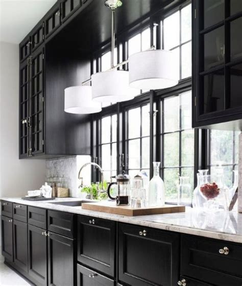 pictures of kitchens with white cabinets and black appliances 1000 ideas about kitchen cabinets on