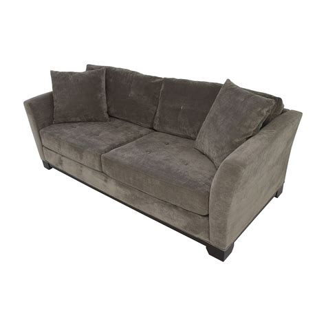 grey leather tufted sofa grey tufted sofa chic glam living room features a gray