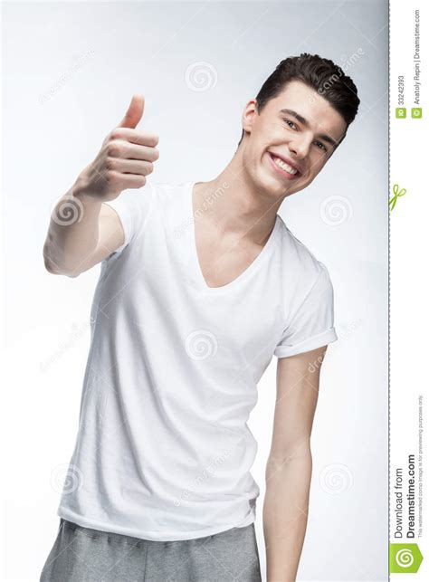 wearing lights wearing white t shirt on light background stock photos