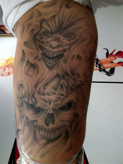horror inner arm tattoo finished shading dark evil faces