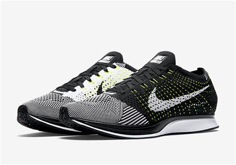 fly knit nike the nike flyknit racer in black white and volt has a