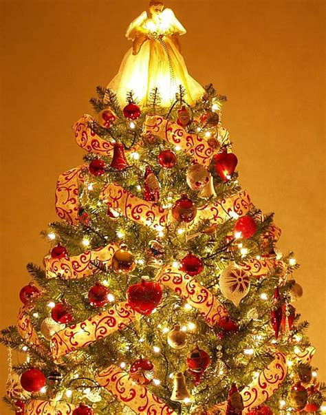 tree decorations and gold tree decorations with gold ribbons happy holidays