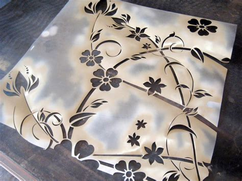 spray painting using stencils how to paint and stencil an wood table how tos diy