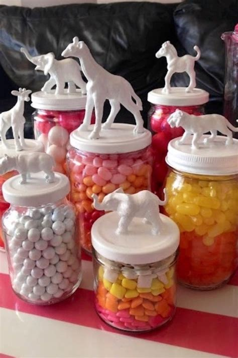 acrylic paint jar lids plastic animal toys glued to the top and then