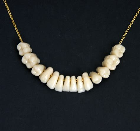 what is jewelry made to order human teeth tooth necklace pendant gold sterling