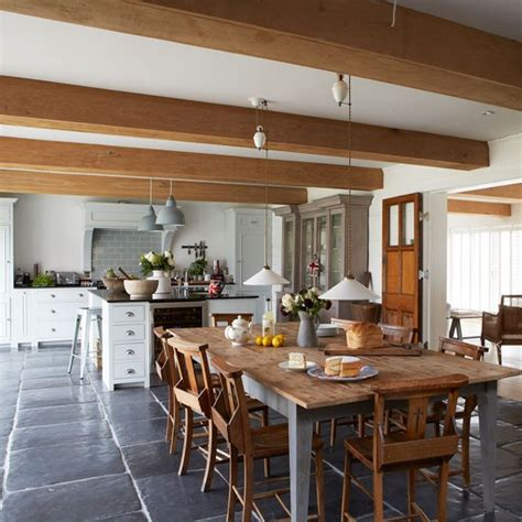 modern country homes interiors farmhouse style kitchen diner with large wooden dining