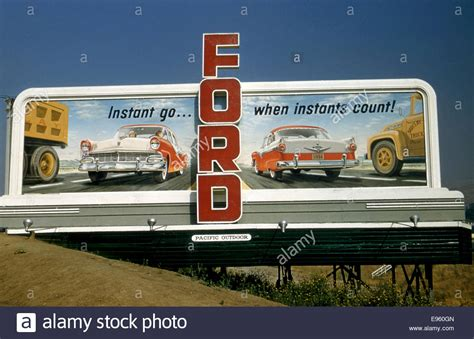 Ford Automobiles by Billboard Advertising Ford Automobiles Circa 1956 Stock
