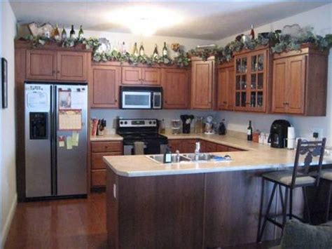 ideas for decorating top of kitchen cabinets 1000 images about above cabinet decorating ideas on