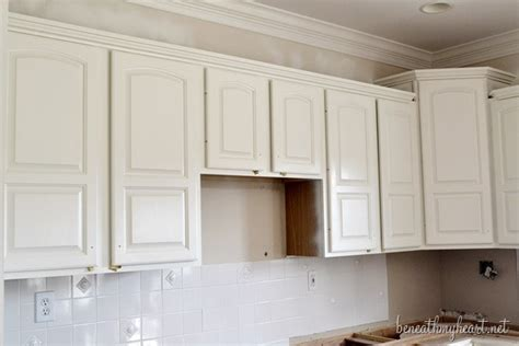 painting kitchen cabinets white beneath my