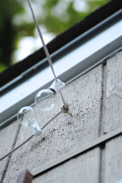 poles to hang string lights how to hang outdoor string lights the deck diaries part