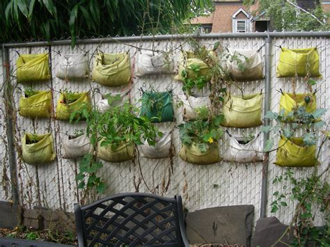 garden vegetable planters recycled plastic planter bags hanging on the wire fence