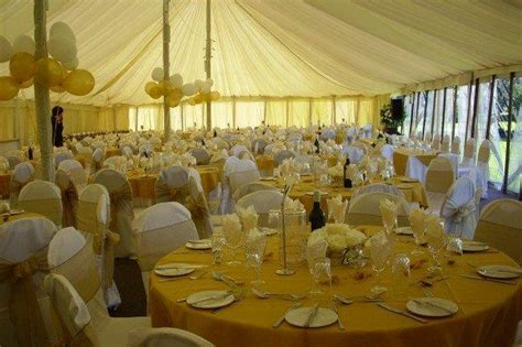 gold and white decorations gold chair covers in a marquee