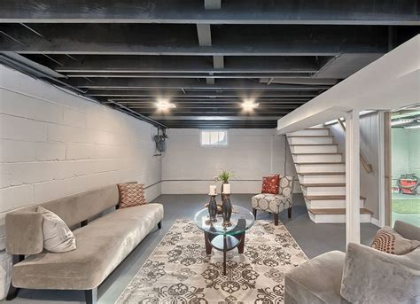 win a basement makeover paint basement rafters unfinished basement ideas 9