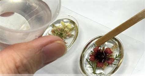 how to make resin jewelry with pictures how to make pressed flower resin jewelry the beading gem