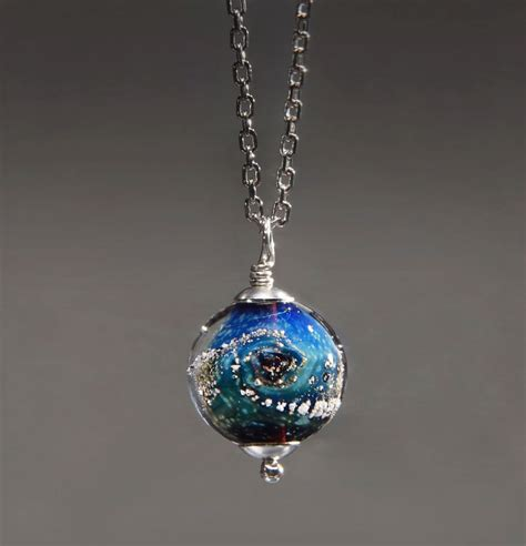 into jewelry capture your loved ones in custom glass planets green