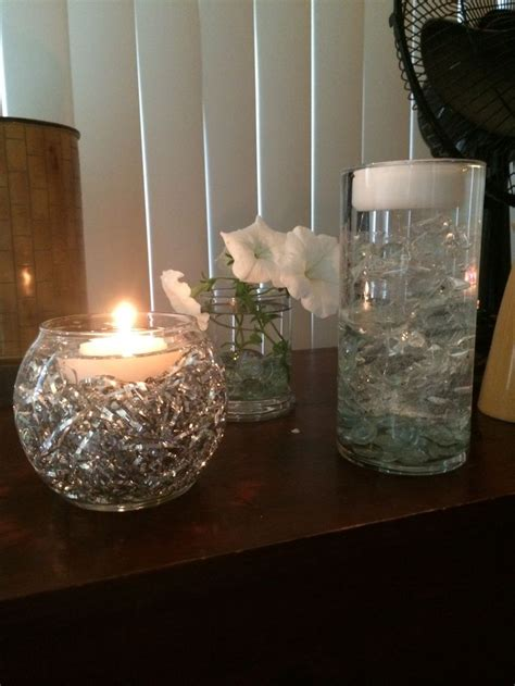 water and floating candles silver tinsel and cellophane submerged in water with
