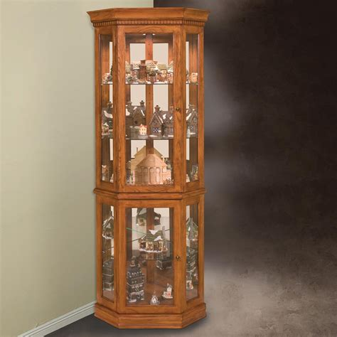 corner curio cabinets philip reinisch company 45951 lighthouse collection classic oak corner curio cabinet atg stores