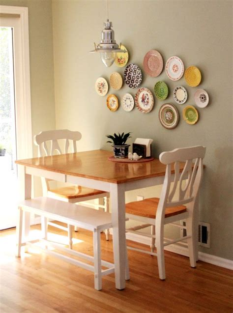 small space dining room table against the wall two chairs one bench seat