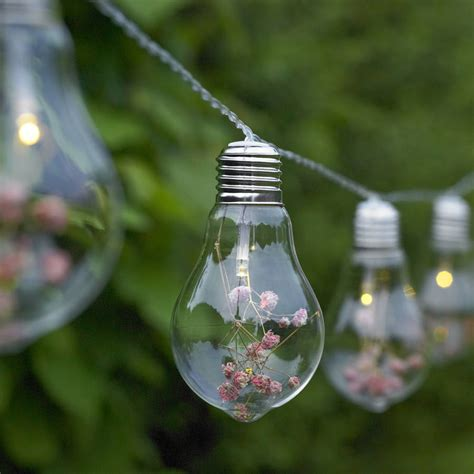 string flower lights glass bulb and flower string lights by garden selections
