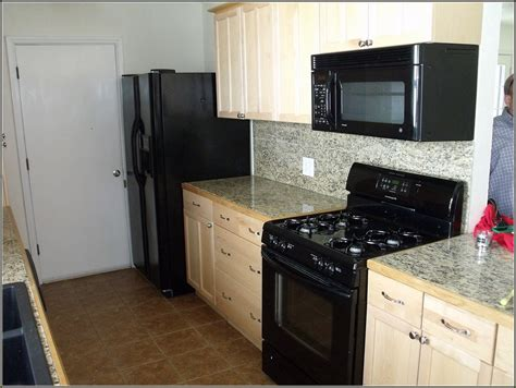 black kitchen cabinets with black appliances white kitchen cabinets with black appliances
